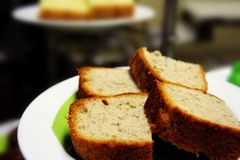 Banana bread. With other cake at background royalty free stock photo