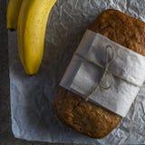 Banana bread with baking paper Stock Photo