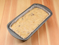 Banana bread batter in a loaf tin Stock Image