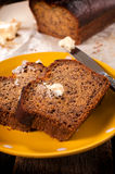 Banana bread and butter on plate Stock Photos