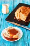 Banana bread with caramel sauce Stock Images
