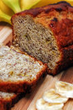 Banana Bread. With cut slices of banana and banana's in the background Royalty Free Stock Image