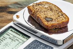 Banana bread on diet scale Stock Images