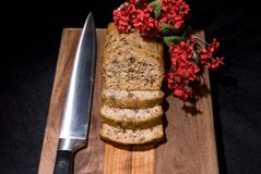 Banana Bread 1. Fresh home baked banana bread loaf displayed on a cutting board Royalty Free Stock Photo
