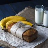 Banana bread, glasses of milk on burlap napkin Stock Photo
