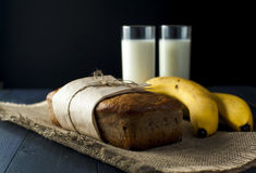 Banana bread, glasses of milk on burlap napkin Royalty Free Stock Photos