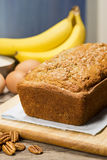 Banana Bread with Ingredients in Background Stock Photo