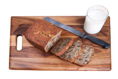 Banana bread and milk over white Stock Photo