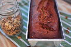 Half loaf of Banana Bread with walnut jar  Royalty Free Stock Image