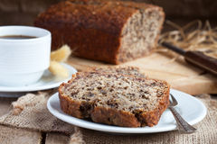 Banana bread with nuts with cup of coffee Royalty Free Stock Photo