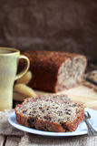 Banana bread with nuts in the white plate on the wooden table Stock Photography
