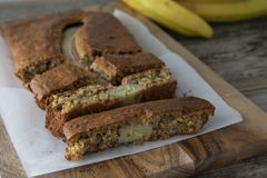 Banana bread with oat flour. Top view of homemade banana bread on wooden background. Ideas and recipes for healthy diet breakfast. Banana bread with oat flour royalty free stock photos