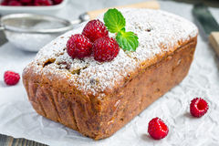 Banana bread with raspberries, cherries and white chocolate, horizontal. Banana bread with raspberries, cherries and white chocolate on parchment, horizontal Stock Photography