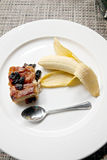 Banana bread and spoon in white dish. Stock Images