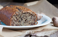Banana bread with walnut on the plate and baking paper Stock Image