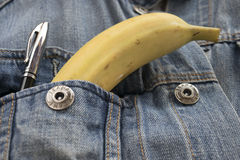 Banana in the breast pocket of a jeans jacket Royalty Free Stock Images