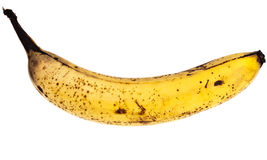 Banana with brown spots Royalty Free Stock Images