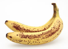 Banana with brown spots. Banana yellow brown two ripe isolated dots Stock Photo
