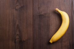 Banana on the brown wooden background Stock Images