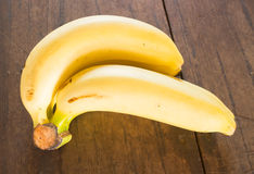 Banana on brown wooden background Royalty Free Stock Image