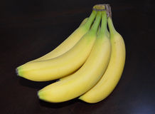 Banana Bunch. Bananas Ripe Yellow Green Dark Background Royalty Free Stock Photography