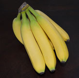 Banana Bunch. Bananas Ripe Yellow Green Dark Background Stock Image