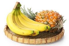 Banana bunch with pineapple Royalty Free Stock Photography