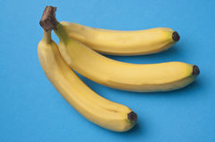 Banana Bunch on Vibrant Blue Stock Image