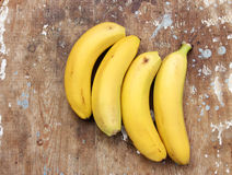 Banana. Bunch on wooden background Stock Photos