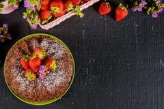 Banana bundt cake with fresh strawberries on the basket. Banana bundt cake decorated with fresh strawberries, homemade, fruit, food, dessert, sweet, baked royalty free stock photography