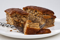 Banana cake. Homemade banana cake on a white plate royalty free stock photos