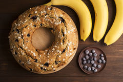 Banana cake with blueberries and cereal. Laid out on the Board with bananas and blueberries on wooden table Stock Photography