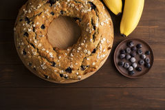 Banana cake with blueberries and cereal. Laid out on the Board with bananas and blueberries on wooden table Stock Photos