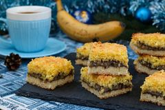 Banana cake with coconut flakes - festive dessert for Christmas, New Year royalty free stock images