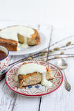 Banana cake with cottage cheese in a creamy sauce with a Cup of Royalty Free Stock Photography