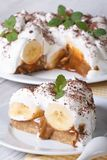 Banana cake with cream and mint close up vertical Royalty Free Stock Photos