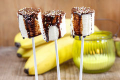 Banana cake pops with chocolate Stock Image