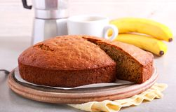 Banana cake, with a slice. Cut out, served on table royalty free stock photos