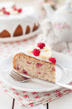 Banana Cake with Sugar Glaze Topped with Raspberries and Banana Stock Images