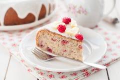 Banana Cake with Sugar Glaze Topped with Raspberries and Banana Royalty Free Stock Photos