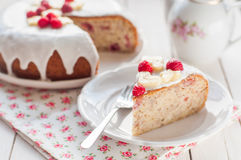Banana Cake with Sugar Glaze Topped with Raspberries and Banana Royalty Free Stock Photo