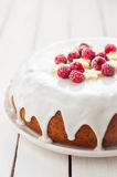 Banana Cake with Sugar Glaze Topped with Raspberries and Banana Royalty Free Stock Image