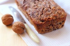 Banana cake with walnuts and dark chocolate Stock Images