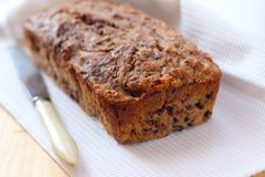 Banana cake with walnuts and dark chocolate Royalty Free Stock Image
