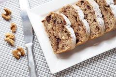 Banana cake with walnuts and dark chocolate Royalty Free Stock Photography