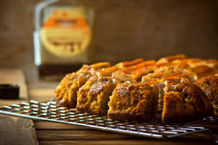 The banana cake with walnuts and maple syrup cut with slices on a wooden table. Royalty Free Stock Images