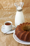 banana cake on a white plate, cup of tea and milk Stock Photo