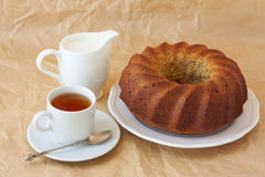 banana cake on a white plate, tea and milk Royalty Free Stock Image