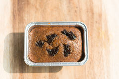 Raisin Cake or Currant Bread. Bakery in Package on wood. freshly baked loaf cake with raisins on a wooden board. appetizing fruitcakes with raisin, a peanut Stock Images