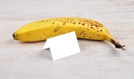 Banana and card Royalty Free Stock Photo